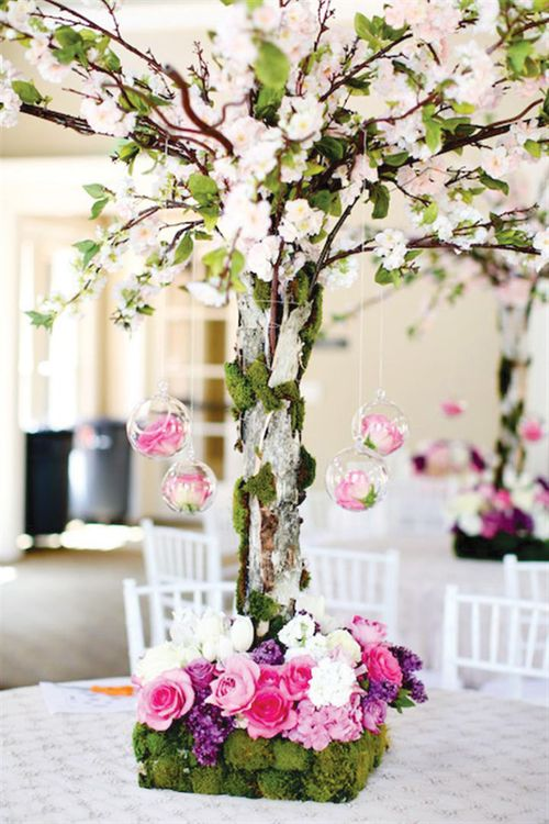 Cultural-first-birthday-celebration-pink-centerpieces-flowers-5